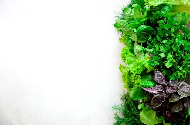 Green fresh aromatic herbs - thyme, basil, parsley. food frame, border design.