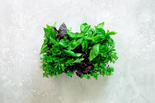 Green fresh aromatic herbs - thyme, basil, parsley