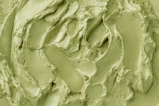 Green frosting texture background close-up