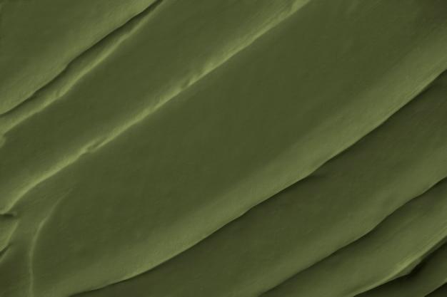 緑のフロスティングテクスチャ背景のクローズアップ