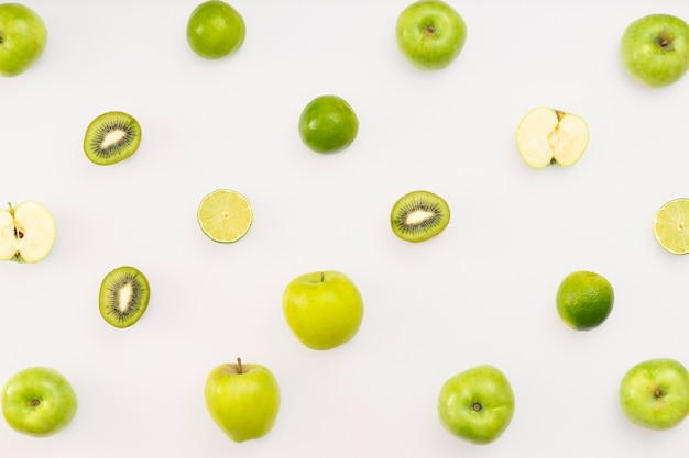 Green fruits on white background