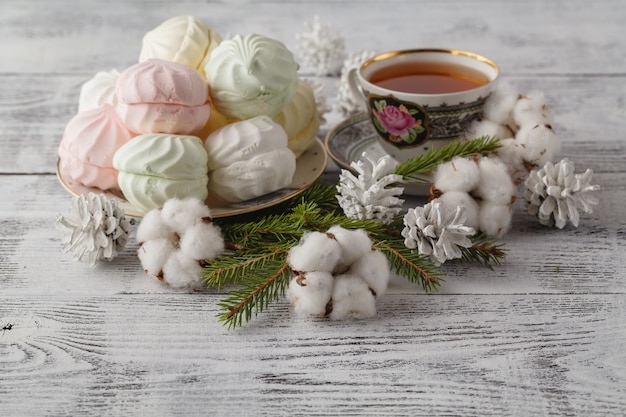 Green fur, cinnamon, cotton christmas composition close-up,