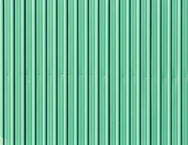Green galvanized steel plate as fence wall,seamless abstract background green with vertical lines