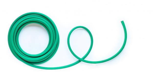 Green garden hose on white background.