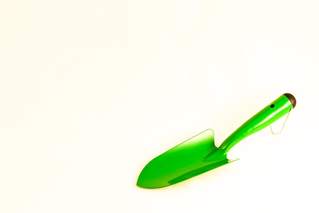 Green garden shovel isolated on white background with copy space