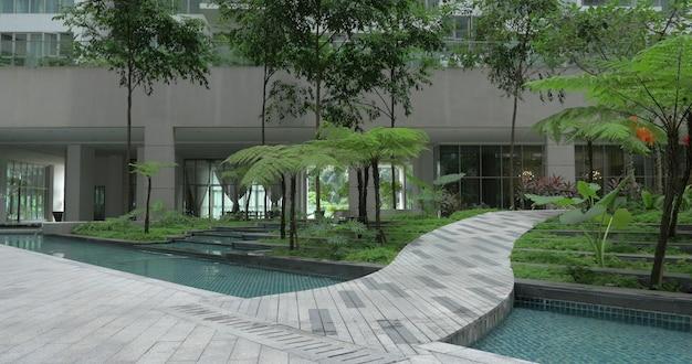 Зеленый сад с декоративными водопадами у подножия многоэтажного жилого дома или отеля в куала-лумпуре, малайзия