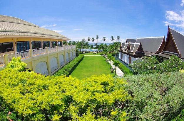 Green garden with luxury hotel