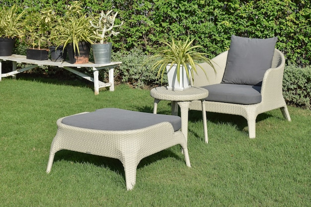 Green garden with an outdoor furniture lounge group with rattan