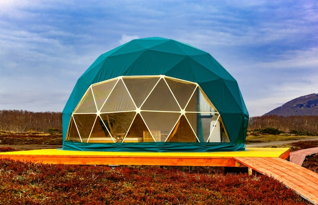 Green geodome tent. cozy, camping, glamping, holiday, vacation lifestyle concept.