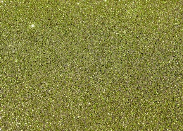 Green glittery texture background abstract
