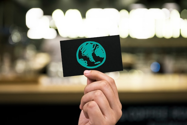 Green globe drawing on a card