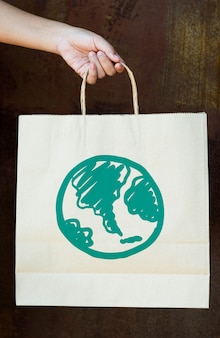 Green globe drawing on a paper bag