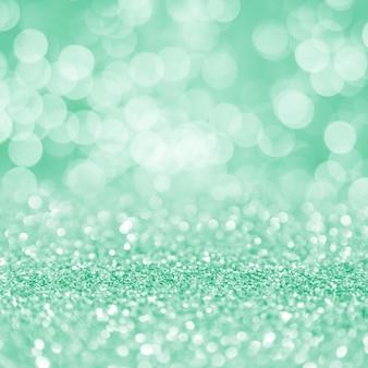 녹색 빛나는 입자 bokeh 사각형 디스플레이 배경
