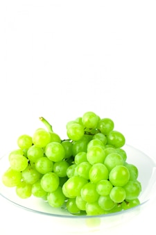 Green grapes in bowl on white background