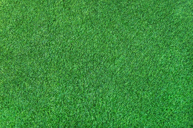 바닥에 인공 녹색 잔디 잔디의 녹색 잔디 배경