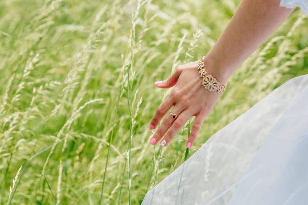 Green grass and female finger