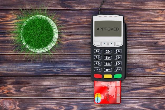 나무 판자 테이블에 신용 카드 결제 터미널 근처의 녹색 잔디 냄비. 3d 렌더링