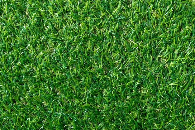 Текстура зеленой травы для предпосылки. зеленый газон узор и текстуру. вид сверху.