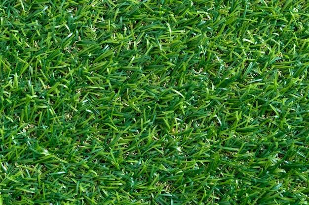 Текстура зеленой травы для предпосылки. зеленый газон узор и текстуру.