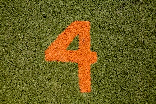 Текстура зеленой травы с номером четыре