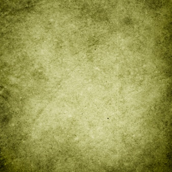 Green grunge background, texture of rough old paper in spots and streaks