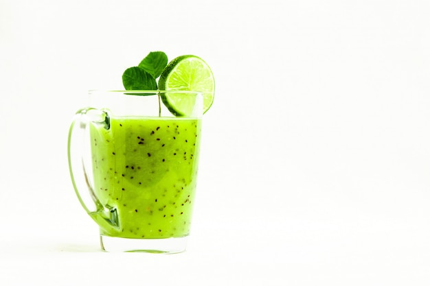 Green healthy cocktail of kiwi, green apple, lime and mint isolated on white background view of a crook