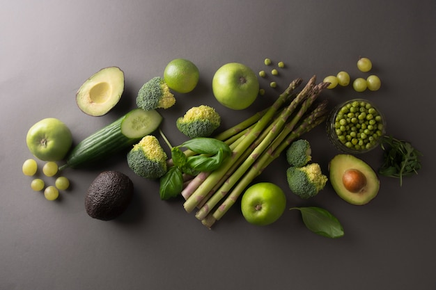 Green healthy food clean eating vegetables, gray background, top view.