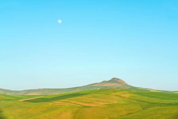 Green hills and blue sky landscape