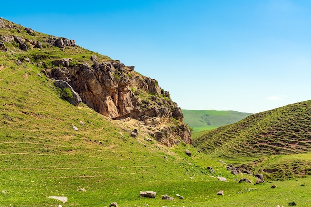 Green hills and cliffs in spring
