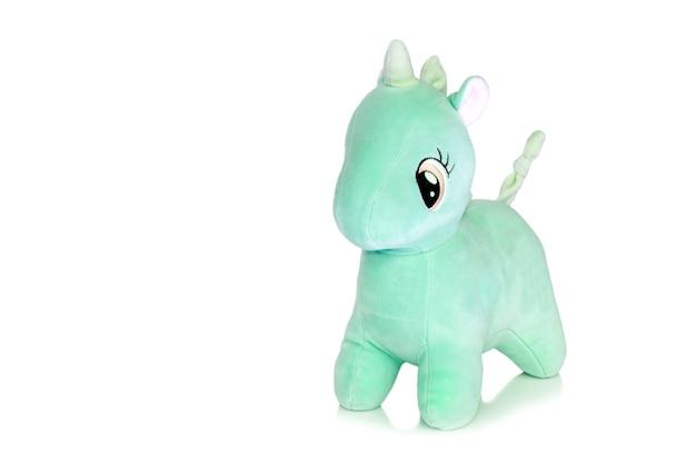 Плюшевый зеленый конь на белом
