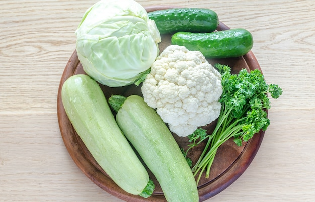 Green hypoallergenic vegetables on a wooden board