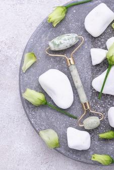 Green jade facial roller for skincare