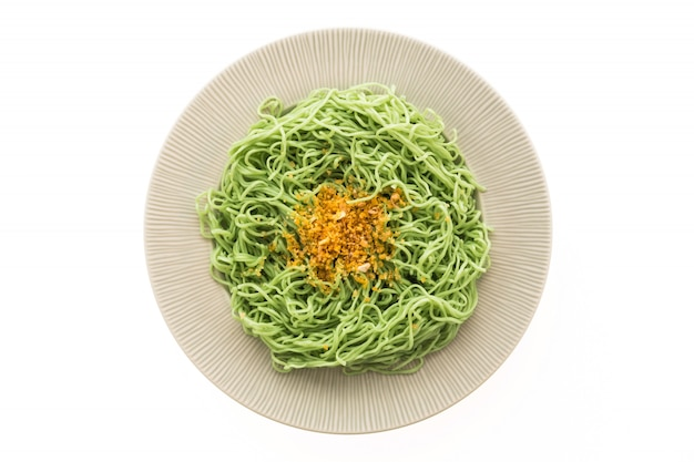 Green or jade noodles in white plate