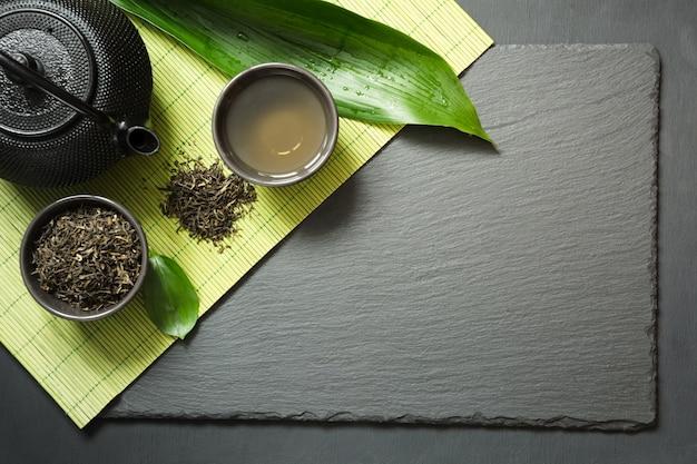 Green japanese tea on black slate