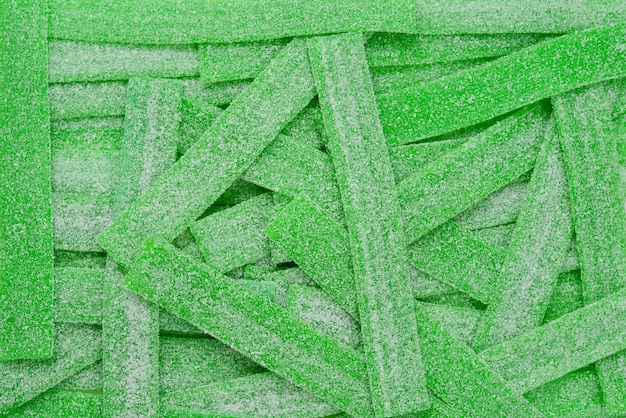 Green juicy gummy candies background. top view. jelly  sweets.