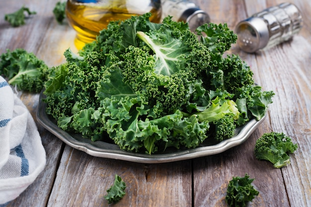 Green kale leaves on plate