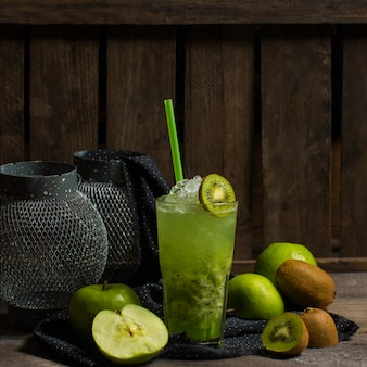 Green kiwi ice cocktail with fruit slices