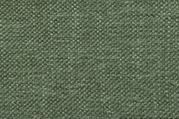 Green knitted woolen background with a pattern of soft, fleecy cloth