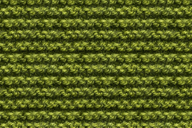 Green knitwear fabric texture. knitting texture macro snapshot. knitted