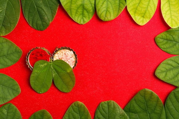 Green leaf and rice composition for indian festival dussehrae