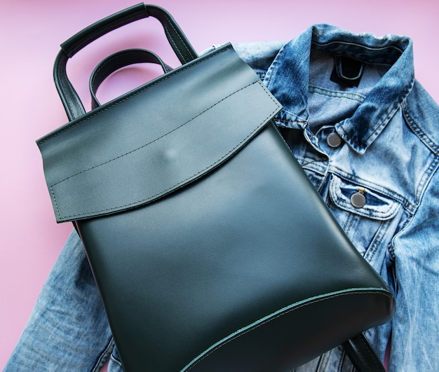 Green leather backpack with sunglasses