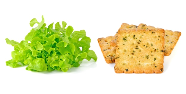 Green leaves lettuce and cracker isolated on white background