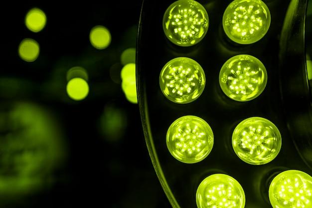Green led light against bokeh backdrop
