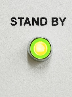 Green led lightning with stand by text over it on the gray panel of the device;