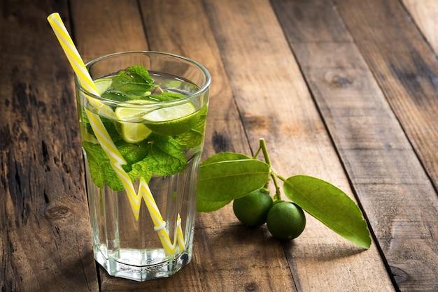 Green lemon juice on wood