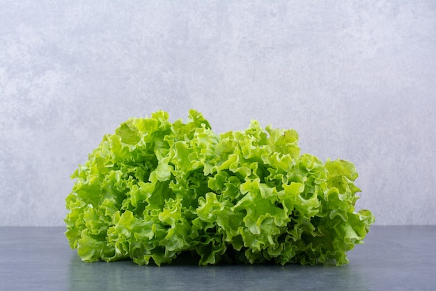 Green lettuce leaves isolated on the surface