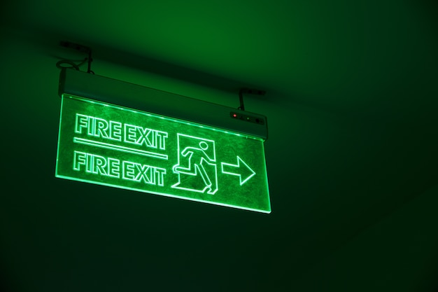 Green light exit sign. emergency way out light sing in the building