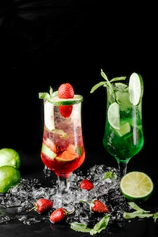 Green lime mojito with mint and red berry cocktails.