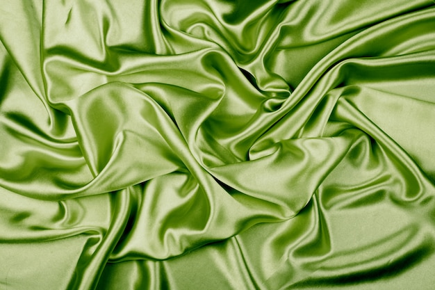 Green luxury satin fabric texture for background