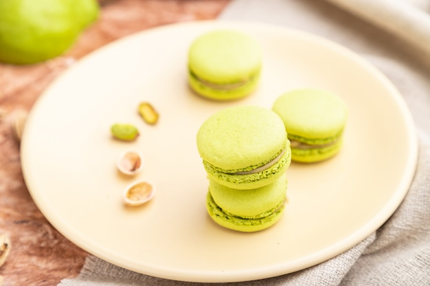 Green macarons or macaroons cakes with cup of coffee